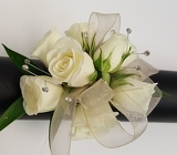 Bedazzled White Wrist Corsage from Lagana Florist in Middletown, CT