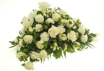 Asymmetrical White Casket Spray from Lagana Florist in Middletown, CT